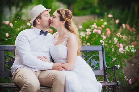 couple dancing: Bride and groom having fun in park
