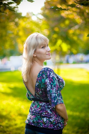 30s: smiling woman in the park 30s Stock Photo