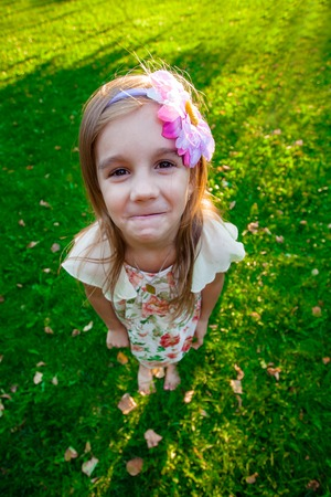 six years: six years old girl in the park Stock Photo