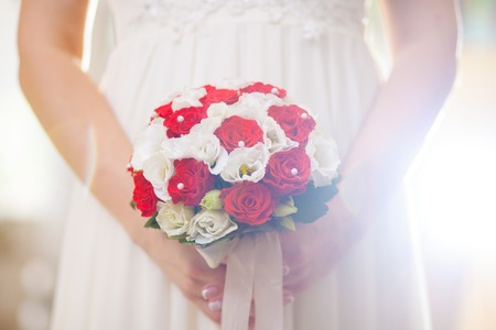red grass: bridal bouquet wedding rose red grass in hand