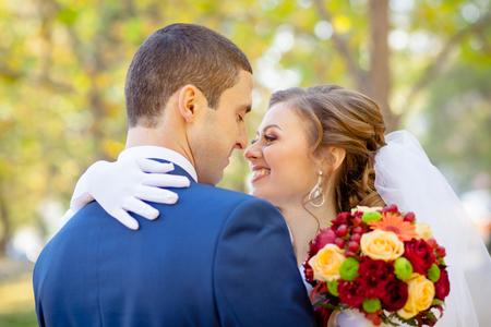 fashionable couple: Gentle hugs and kisses the bride and groom wedding Stock Photo