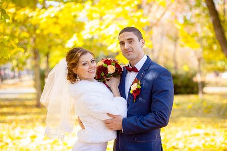 autumn wedding bride and groom on the street sunny Stock Photo