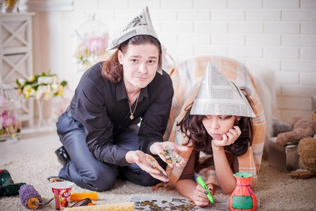 repairs: Young couple making repairs at home Stock Photo