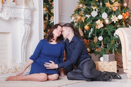 young tree: young couple near a Christmas tree man woman Stock Photo