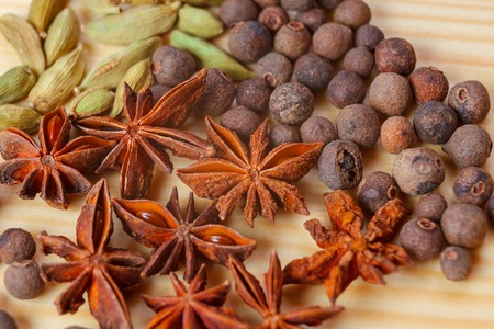 anice: cardamon spice anice pepper wooden Stock Photo