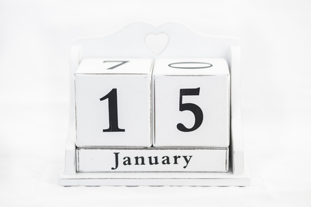 15 months old: calendar january date white wood Stock Photo