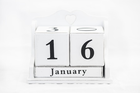 16 year old: calendar january date white wood Stock Photo