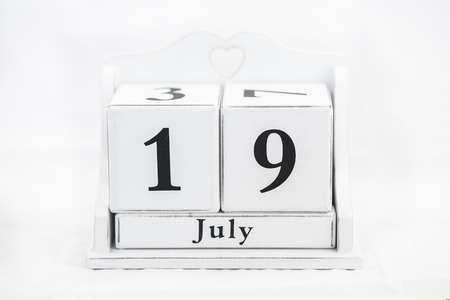 19 year old: calendar july number white cube Stock Photo