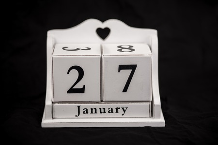27 years old: Calendar cubes black background seasons Stock Photo