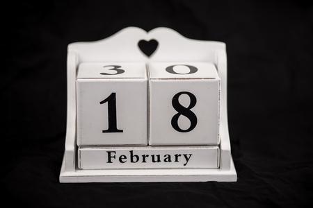 18 month old: Calendar cubes black background seasons Stock Photo