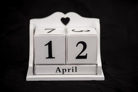12 month old: Calendar cubes black background seasons Stock Photo