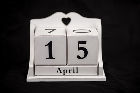 number 15: Calendar cubes black background seasons Stock Photo