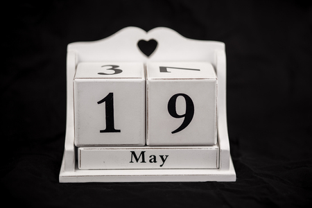 19 years old: Calendar cubes black background seasons Stock Photo
