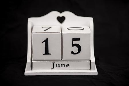 15 months old: Calendar cubes black background seasons Stock Photo