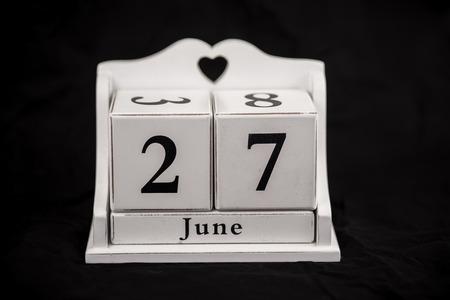 27 years old: Calendar cubes black background seasons Stock Photo
