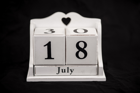18 year old: Calendar cubes black background seasons Stock Photo