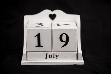 19 year old: Calendar cubes black background seasons Stock Photo