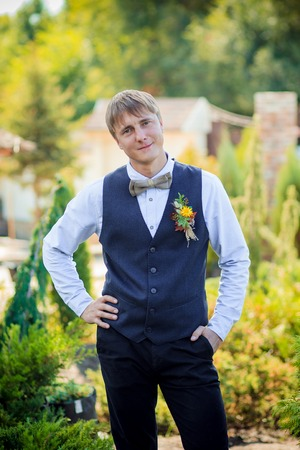 boutonniere: suit of groom with bow tie and boutonniere happy Stock Photo
