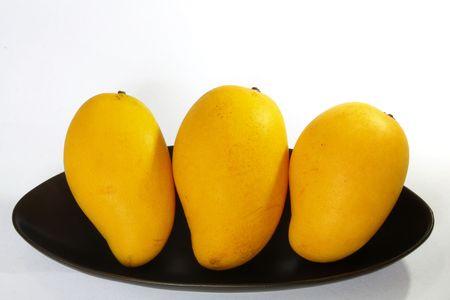 Yellow mango isolated on white background Reklamní fotografie