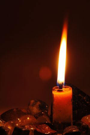candle on dark background.it feel alone.