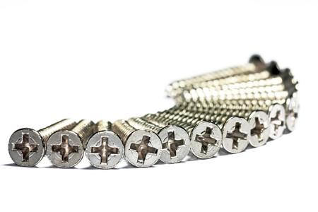 silver screws on white background  Reklamní fotografie