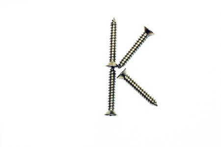 letter k made of screw  isolated on white  photo