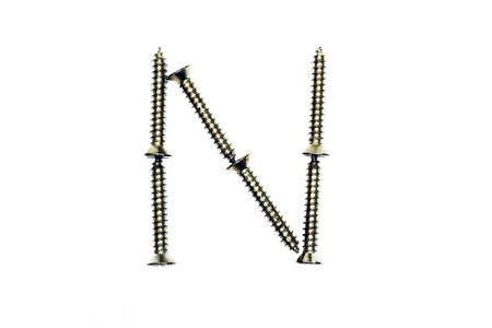 letter n made of screw  isolated on white  photo