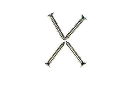 letter x made of screw  isolated on white  photo