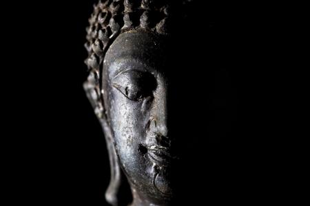 Light of Buddha image in the dark background. Stock Photo - 8700438