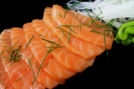 Close-up image of smoked salmon on black background