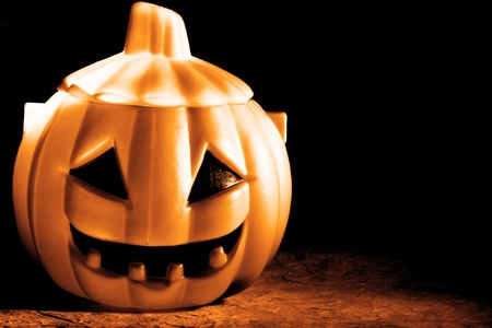 Scary Pumpkin within a dark background Stock Photo - 10919078