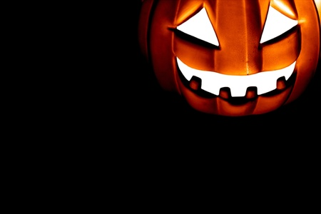 Scary Pumpkin within a dark background photo