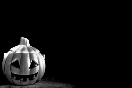 Scary Pumpkin within a dark background Stock Photo - 10919074