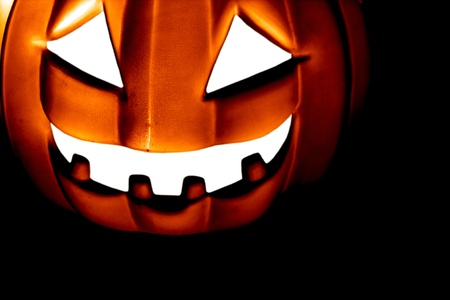 Scary Pumpkin within a dark background Stock Photo - 10919077