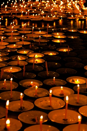 Many burning candles photo