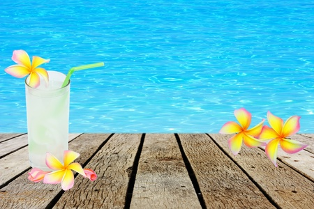 fresh tender green coconut drink on tropical beach photo