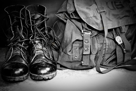 Black leather army boots and Army bag soldier photo