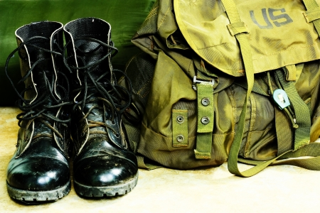 sack truck: Black leather army boots and Army bag soldier Stock Photo