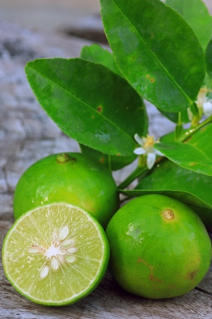 Fresh limes on wooden background photo