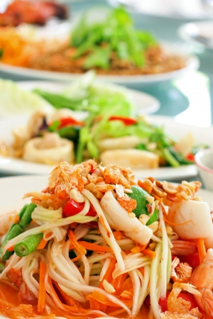 Thai papaya spicy salad or know as Som Tum  photo