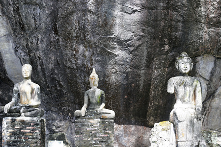 head wise: Old ancient buddha statue on background
