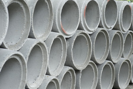 drainage: Concrete drainage pipes stacked on construction site