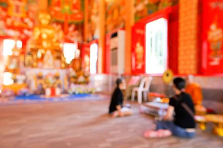 Blurred motion of people walking around temple Foto de archivo