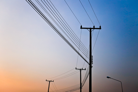 electric grid: high voltage post.High-voltage and sky background. Stock Photo