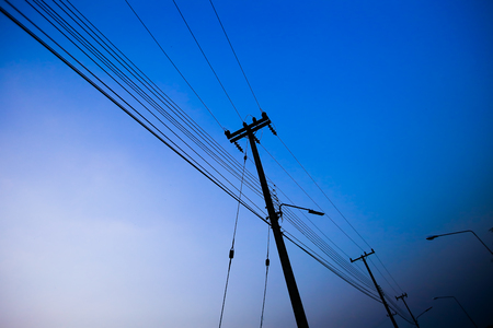 Electricity poles on colorful sky at sunset