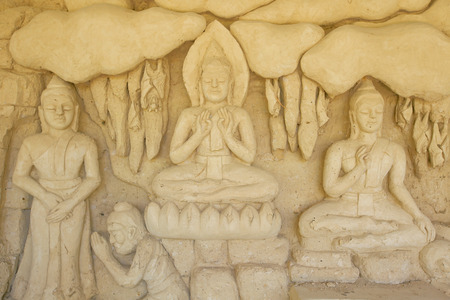 Buddha golden sculpture on lightened background Stock Photo