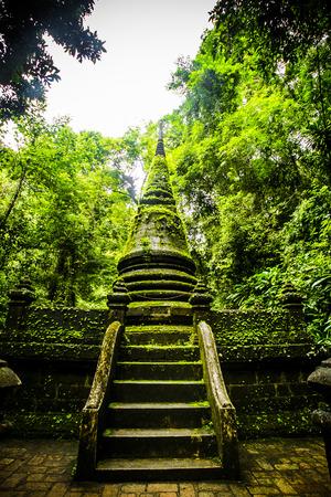 Old pagoda and moss at Phlio waterfall national park,Chanthaburi at Thailand.