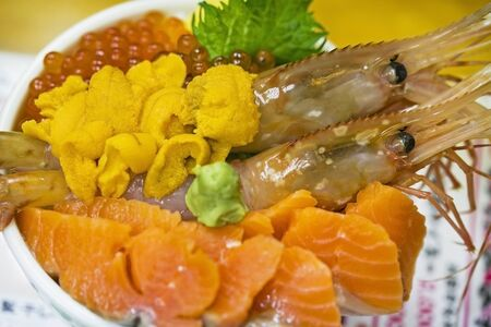 Rice with sashimi raw fish seafood on rice bowl Imagens