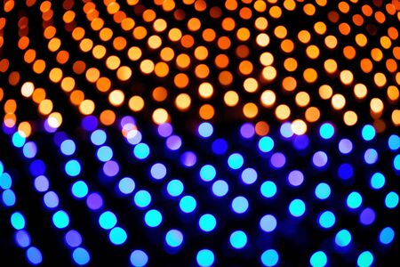 Christmas background. Festive abstract background with bokeh defocused lights and stars 写真素材