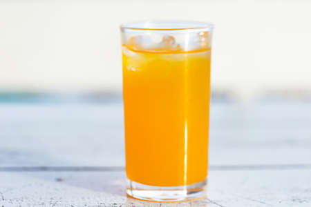 Freshly squeezed orange juice is good to eat with anything. High in vitamin C, can be drunk by all ages Imagens